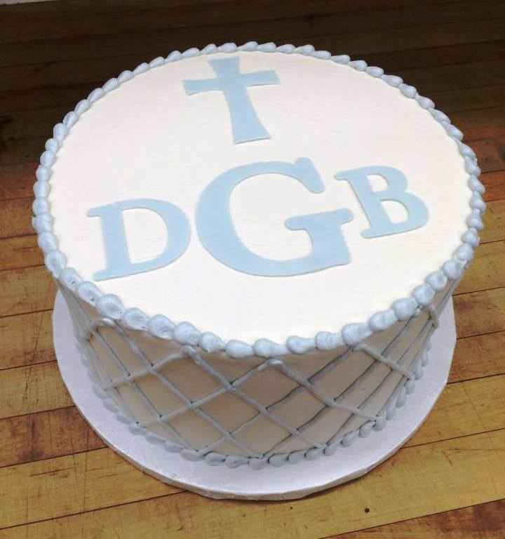 Round Cake with Blue Fondant Cross and Monogram