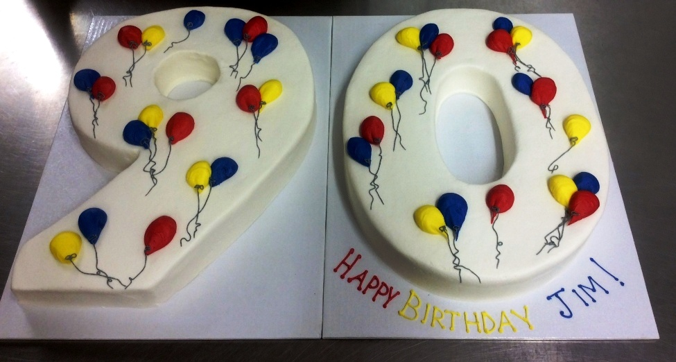 Ninety Shaped Cake with Primary Colored Balloons