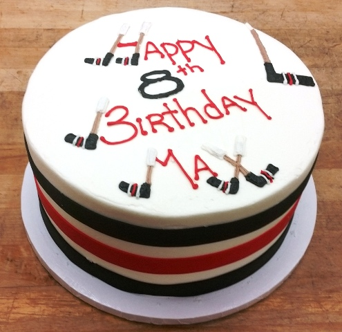 Round Cake with Hockey Sticks and Stripes