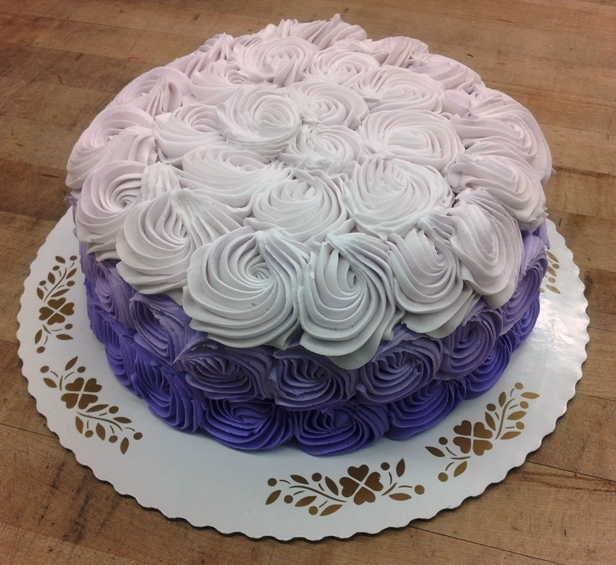 Round Cake covered in Purple Rosettes