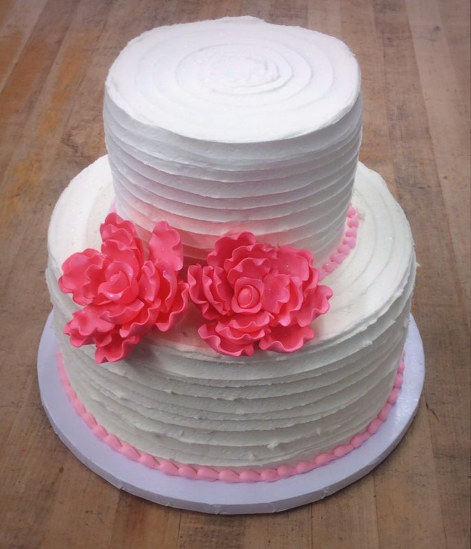 Party Cake with Ribbon Stucco and Pink Flowers