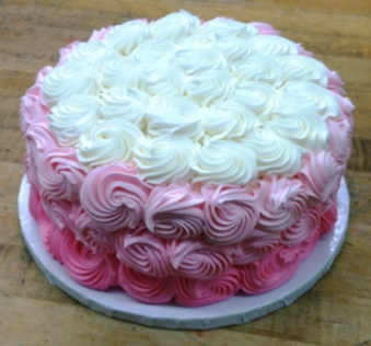 Round Cake covered in Pink Rosettes