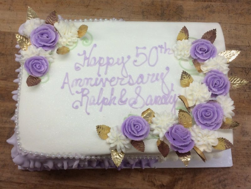 Anniversary Cake with Purple Flowers and Gold Leaves