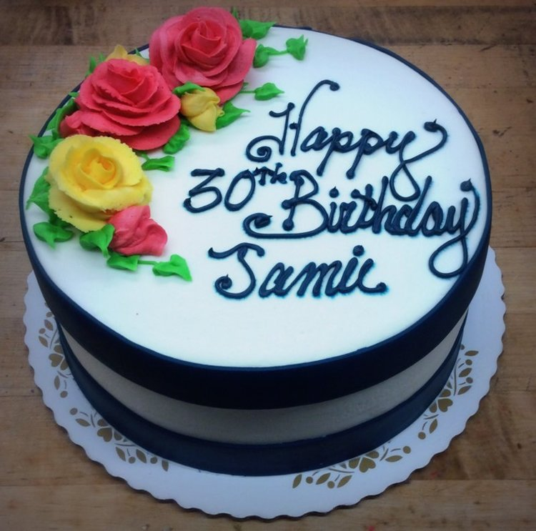 Round Birthday Cake With Big Roses And Fondant Bands Trefzgers Bakery
