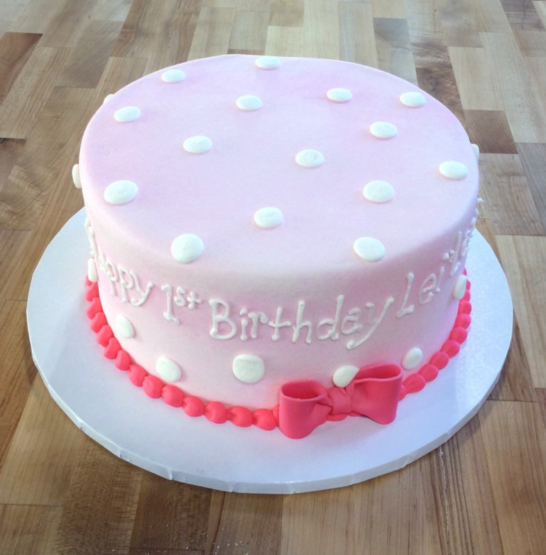 Pink Cake with White Polka Dots and Pink Bow