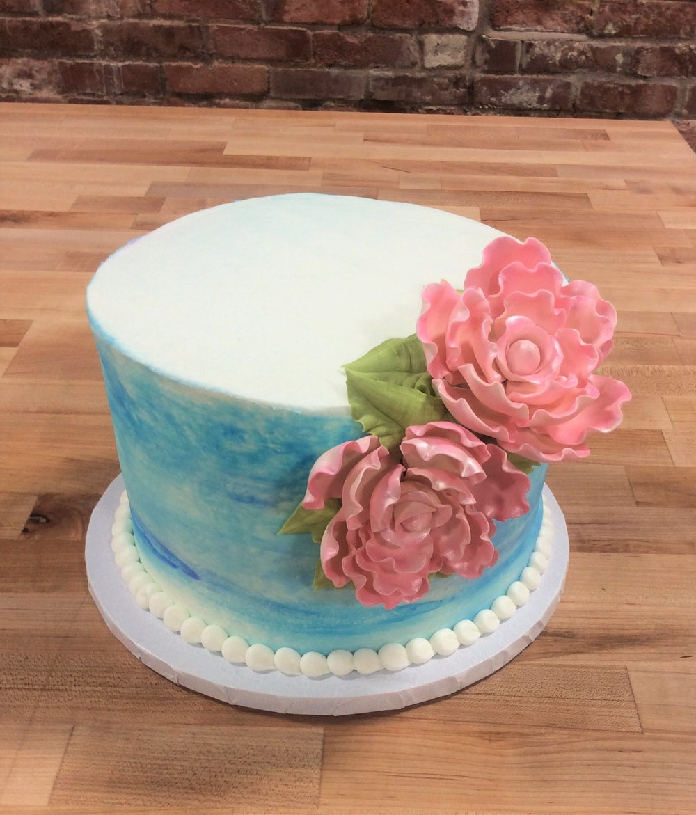 Round Cake with Blue Sides and Pink Gumpaste Flowers