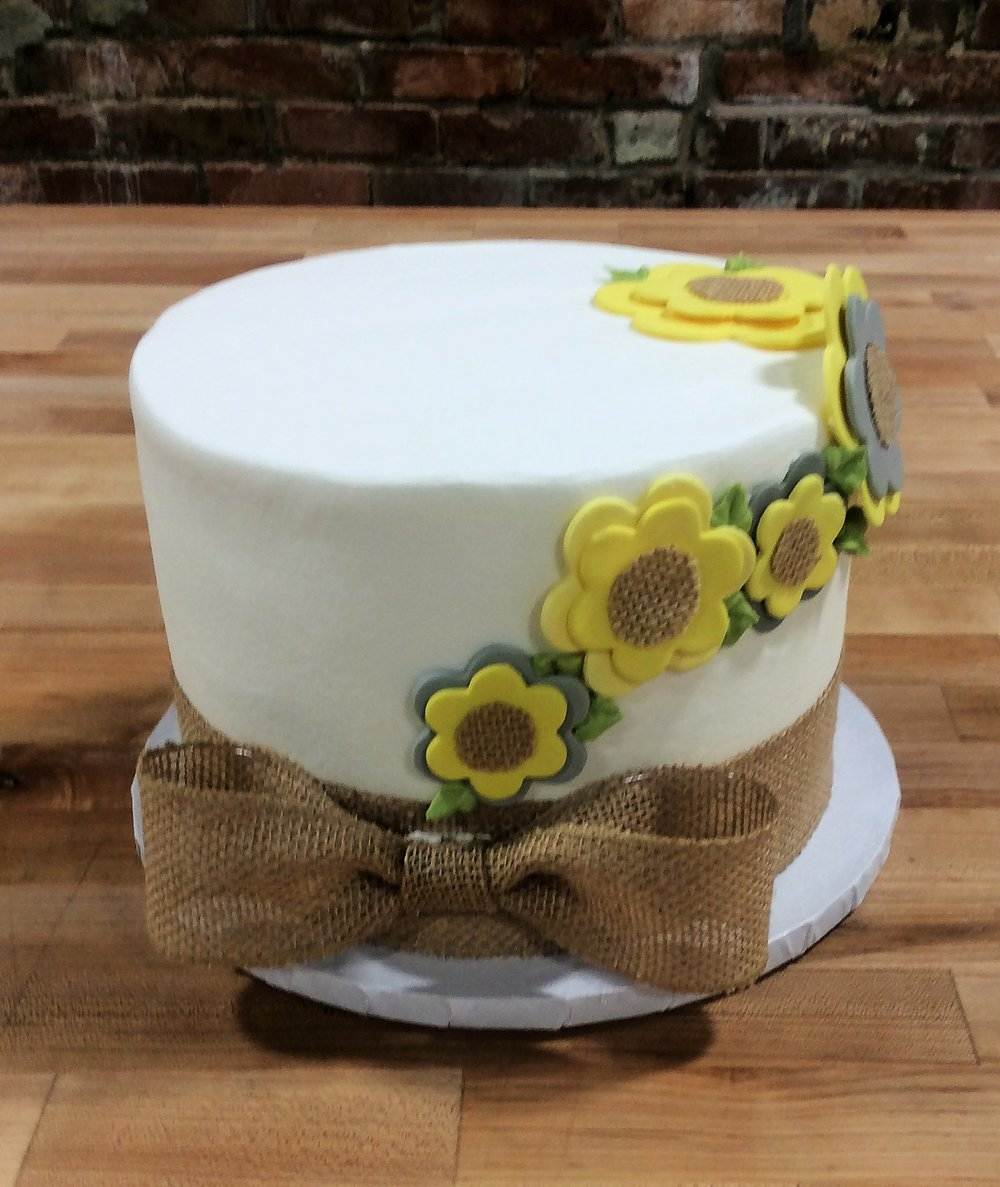 Round Cake with Yellow Fondant Flowers