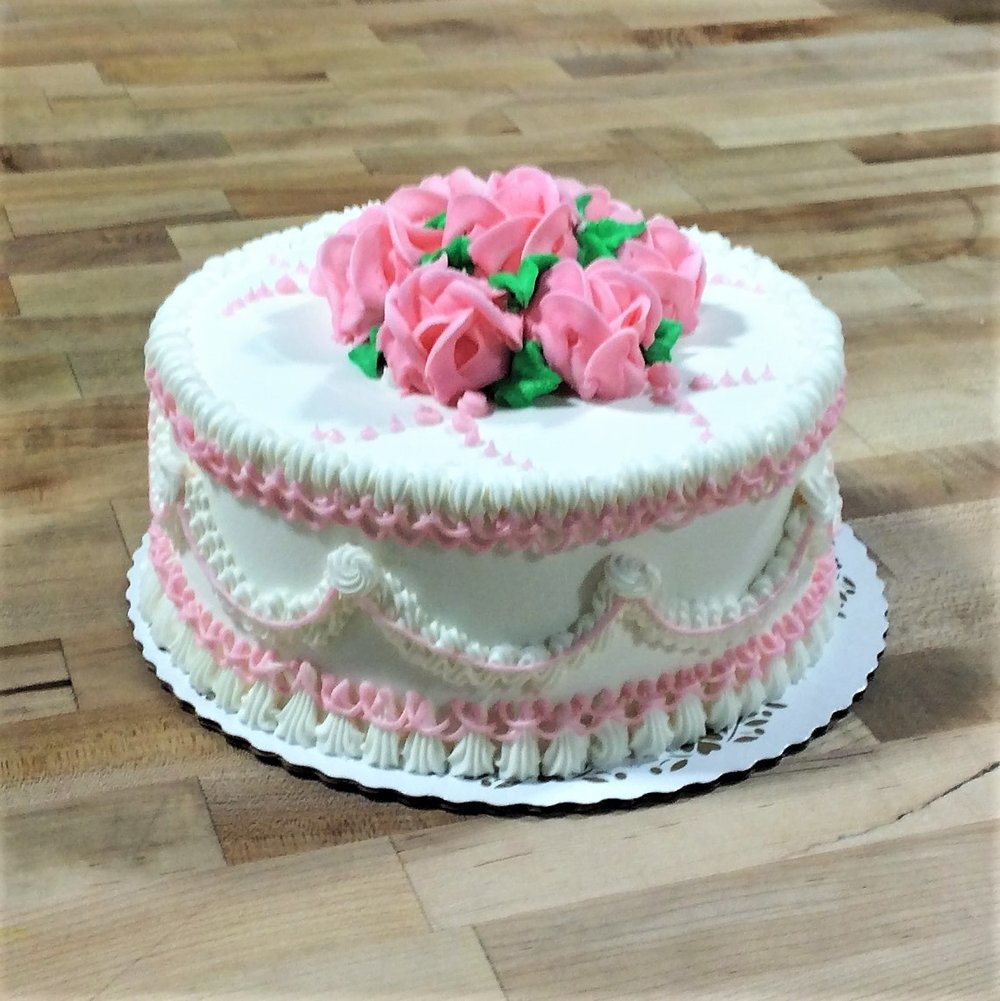 Round Cake with Pink Roses and Swag Sides