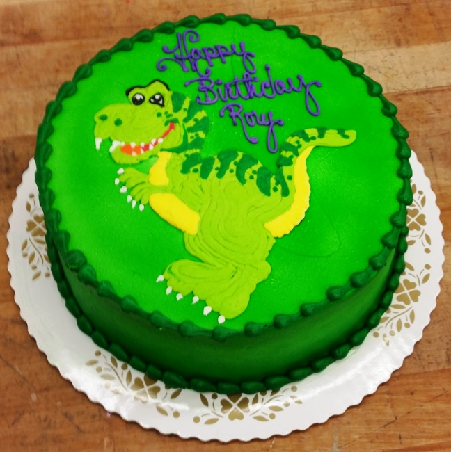 Round Cake with Piped TRex Trefzgers Bakery