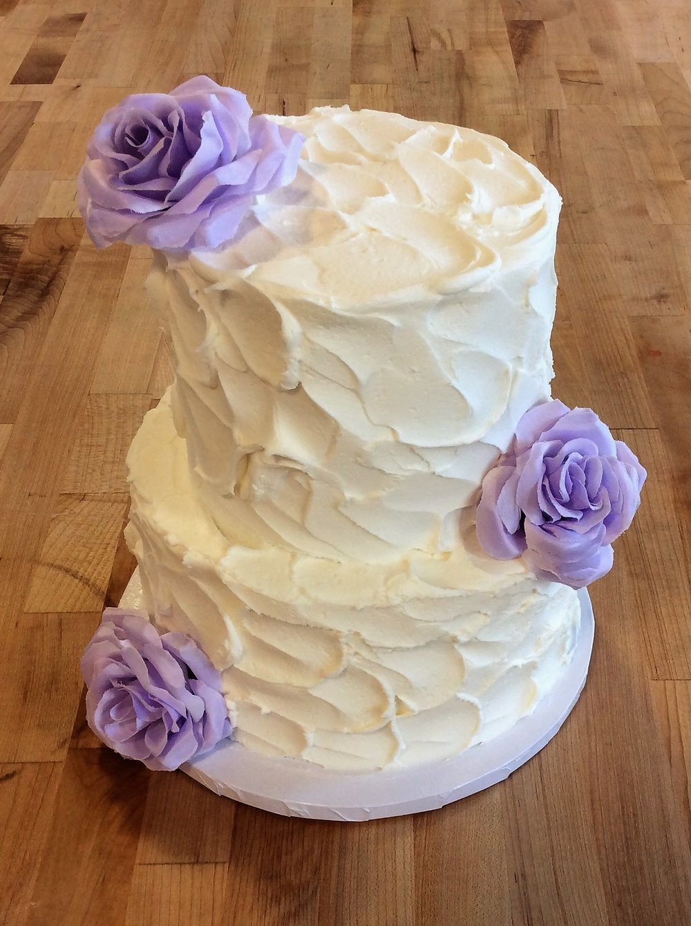 White Stucco Party Cake with Purple Roses