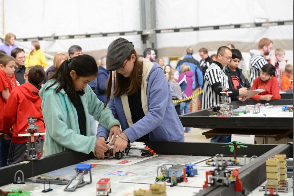 FLL challenges teams to conceive, build, program and test robots to compete in a variety of challenges in a 2.5 minute game time. Teamwork is learned just as much as technical and programming skills.