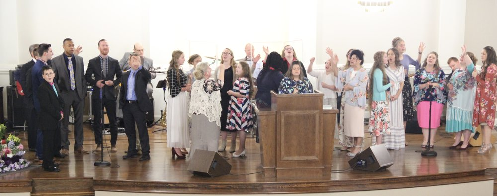 Singing praises unto the Lord.