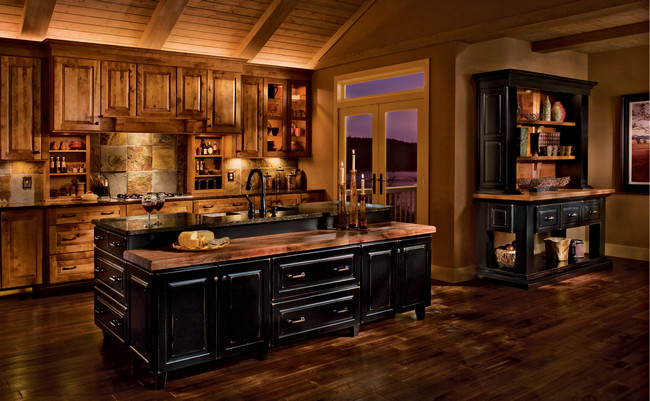 To create an upscale mountain retreat, enhance rustic birch cabinetry in Praline with an island and hutch in dramatic Vintage Onyx.