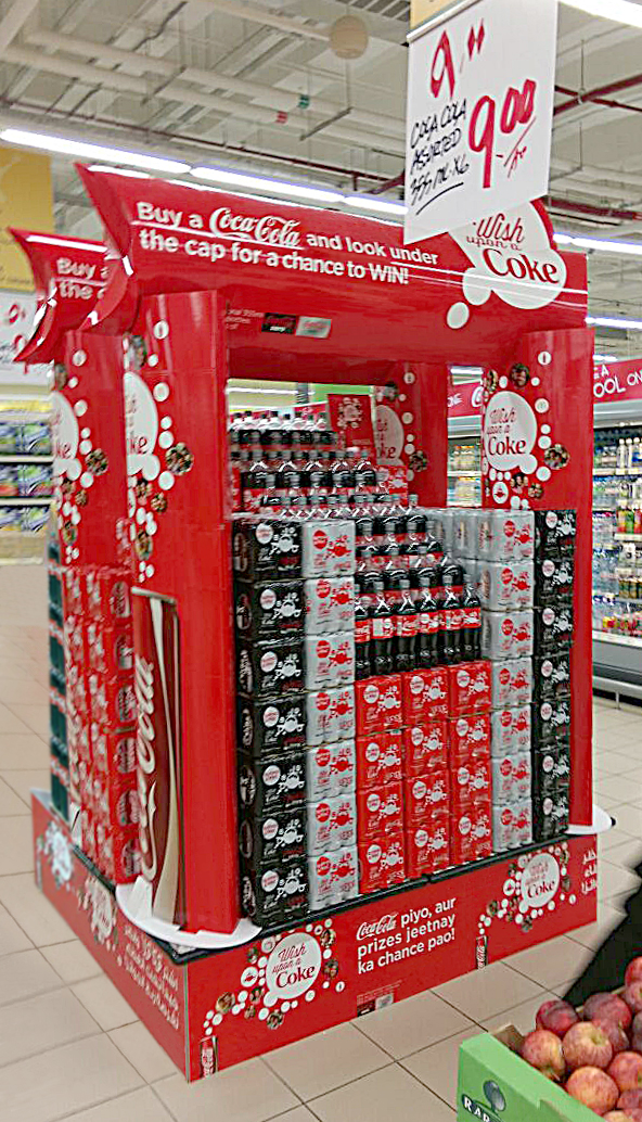 We made danglers and door stickers for neighbourhood grocery stores to large promo island displays inside hypermarkets just like this one displayed special shrink wrapped promo cans.