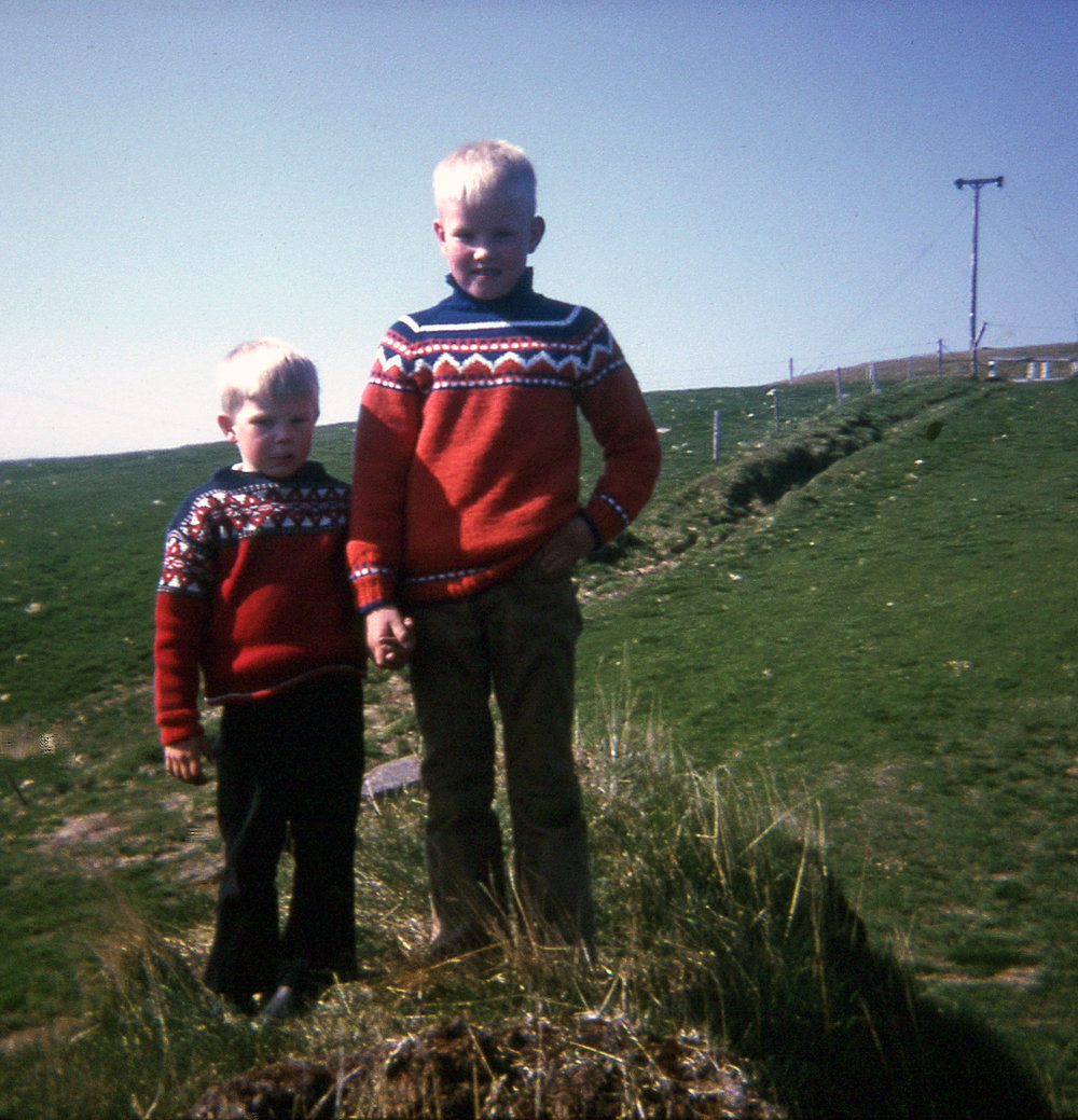 My brothers in identical wool sweaters