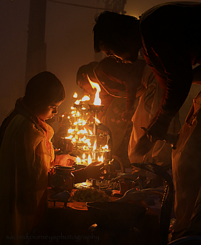 Lighting the butter lamps for the         early morning Aarti ceremony at                 Assi Ghat in Varanasi