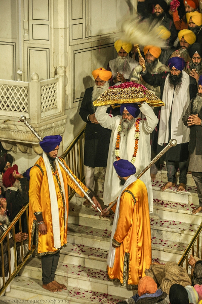 The Guru's journey from the Akal Takhat to The Golden Temple in the                     early morning