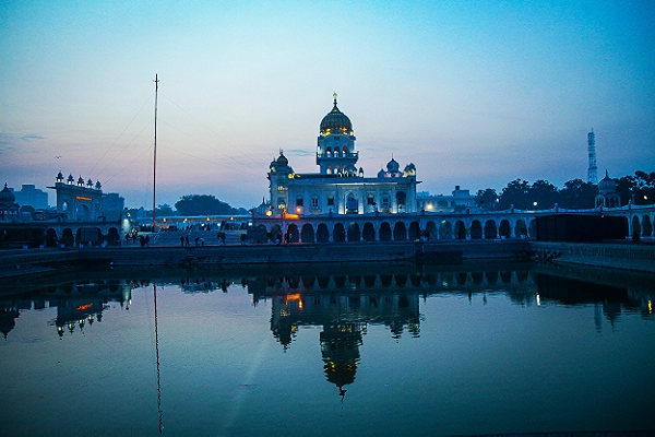 Meditation at the edge of the sarovar (sacred pool) at                        Bangla Sahib Gurdwara