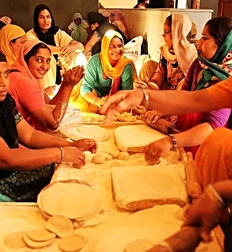 Experience the joy of serving in  the largest free kitchen in the worl d adjacent to the Golden Temple  the langar hall serves 80,000 people per day  ~ All are welcome ~  We'll learn to make chapatis from the masters