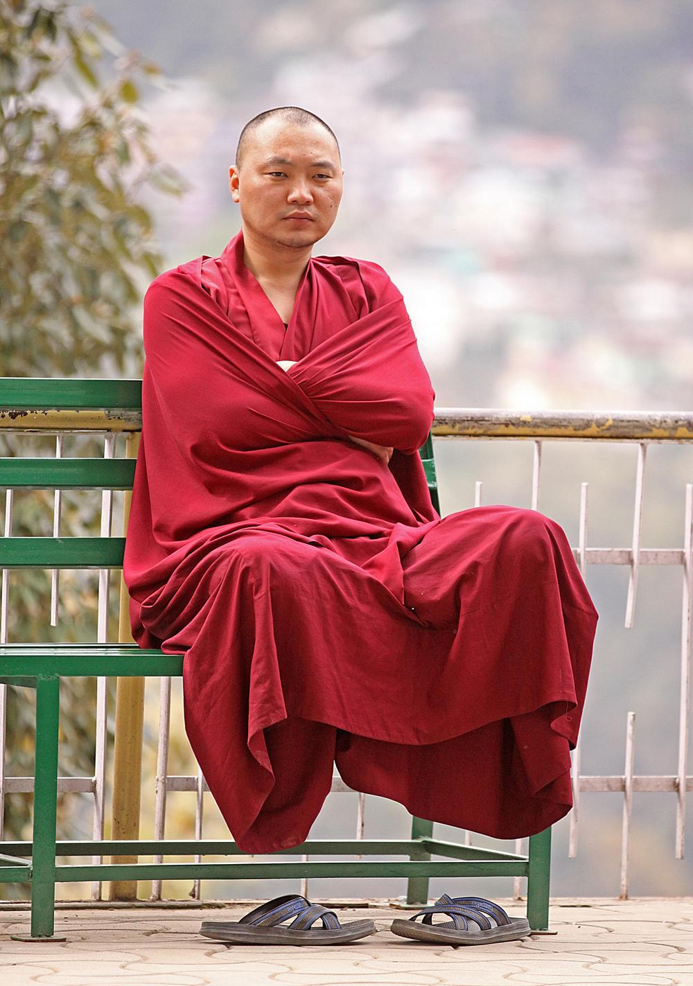 Website Dharmsala Buddhist sitting arms crossed.jpg