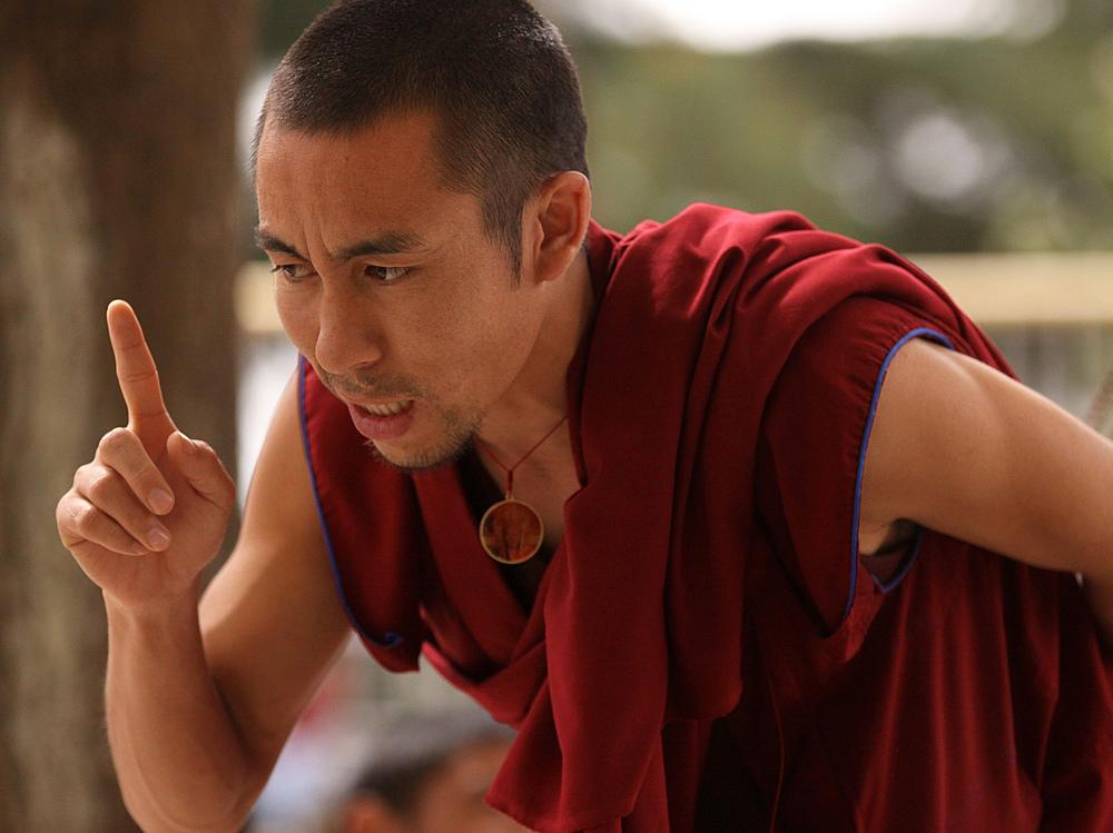 Website Dharmsala debating monk with finger.jpg