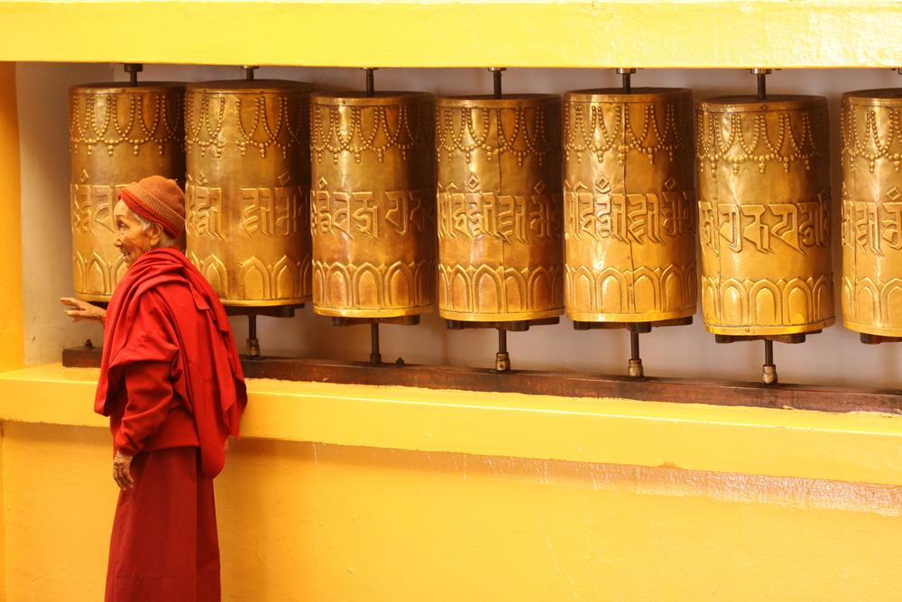 Website Dharmsala old man and prayer wheels.jpg
