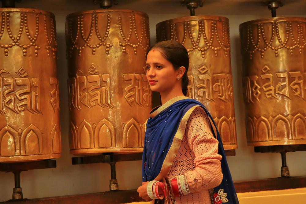 Website Dharmsala Indian woman and prayer wheels.jpg