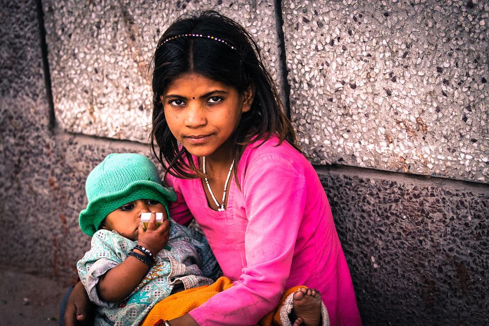 children Muslim girl with baby Jama Masjid.jpg