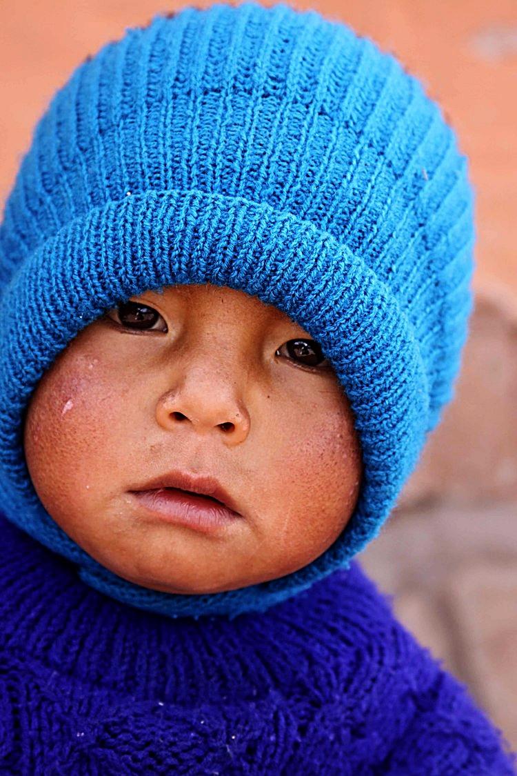 Peru W little boy in blue.jpg