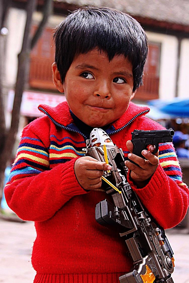 children Calca boy with guns.jpg
