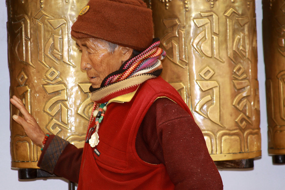 Website+Dharmsala+man+and+prayer+wheel.jpg