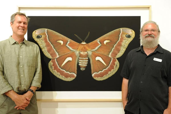 Scott and Jim on opening night at the G2 Gallery with a large print of a Ceanothus Silk Moth.