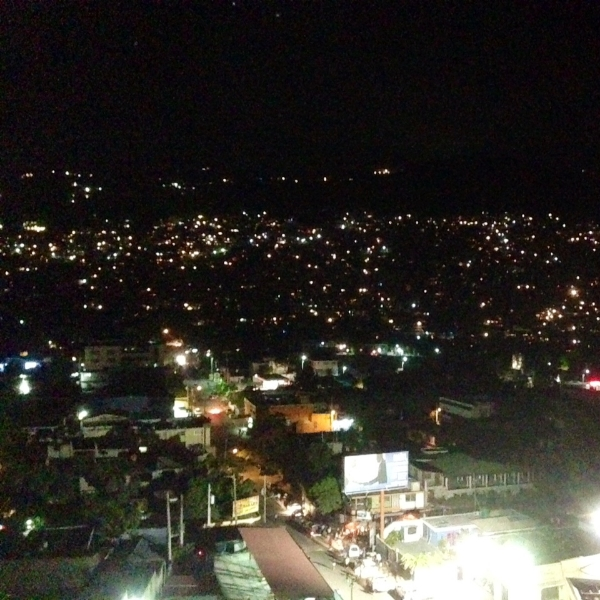 Favelas at night as seen from the Royal Oasis Hotel Rooftop in Petion-Ville, Haiti.