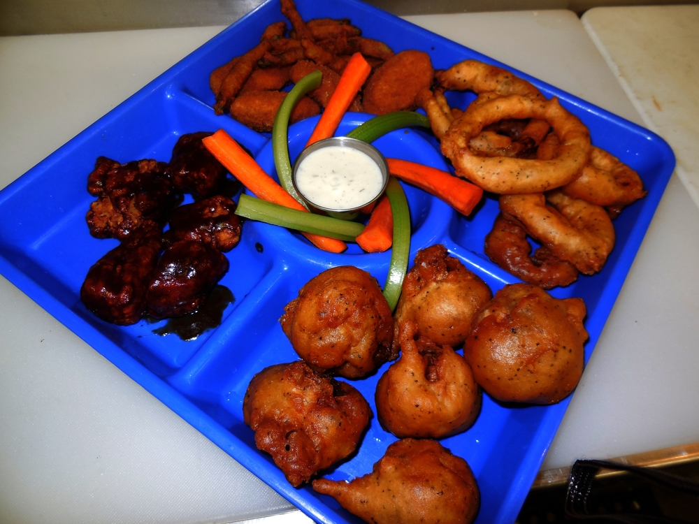 Try a little bit of everything -- wings, fried green beans, fried mushrooms, jalapeno poppers, and onion rings --with our Appetizer Sampler.