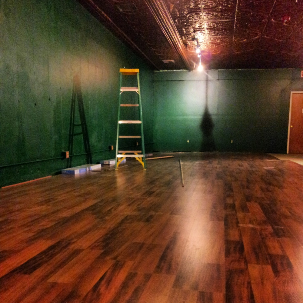 Brand new flooring. A little brighter that the bar side.