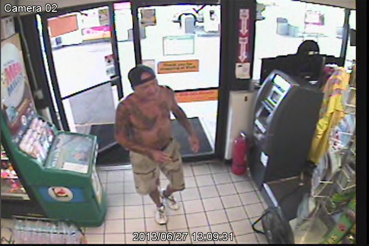 Suspect entering store at front door.