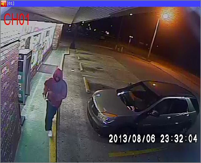 PHOTO:  A still photo taken from surveillance video shows one of the suspects outside the 7-11.  The suspect is a W/M wearing a red hoodie, dark pants, and white tennis shoes.  Click through the photo gallery below for additional photos.  (Photo Courtesy of Cape Coral Police Department)