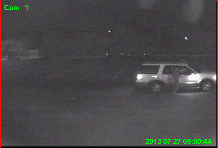PHOTO:  A still taken from security camera footage shows our suspect exiting a light colored, mid-2000's Ford Explorer in the  hustler's parking lot.  (Photo Courtesy of Cape Coral Police Department)