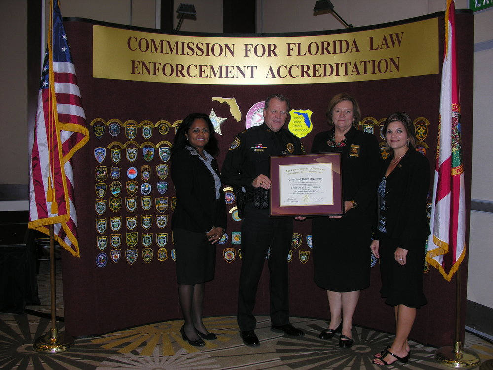 "PHOTO:  in this Photo, interim Chief of Police Bart Connelly and Accreditation Manager, Anella ""Joy"" Nyack are presented with a Certificate of Accreditation at a meeting held in Sarasota, FL on September 25, 2013.  (Photo Courtesy of Cape Coral Police Department)"