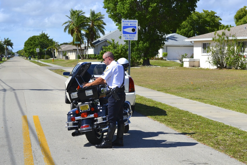 PHOTO:  Officer Patrick Taylor of the Cape Coral Police Department Motorcycle Unit conducts a traffic stop in a neighborhood. (Photo courtesy of Cape Coral Police Department)