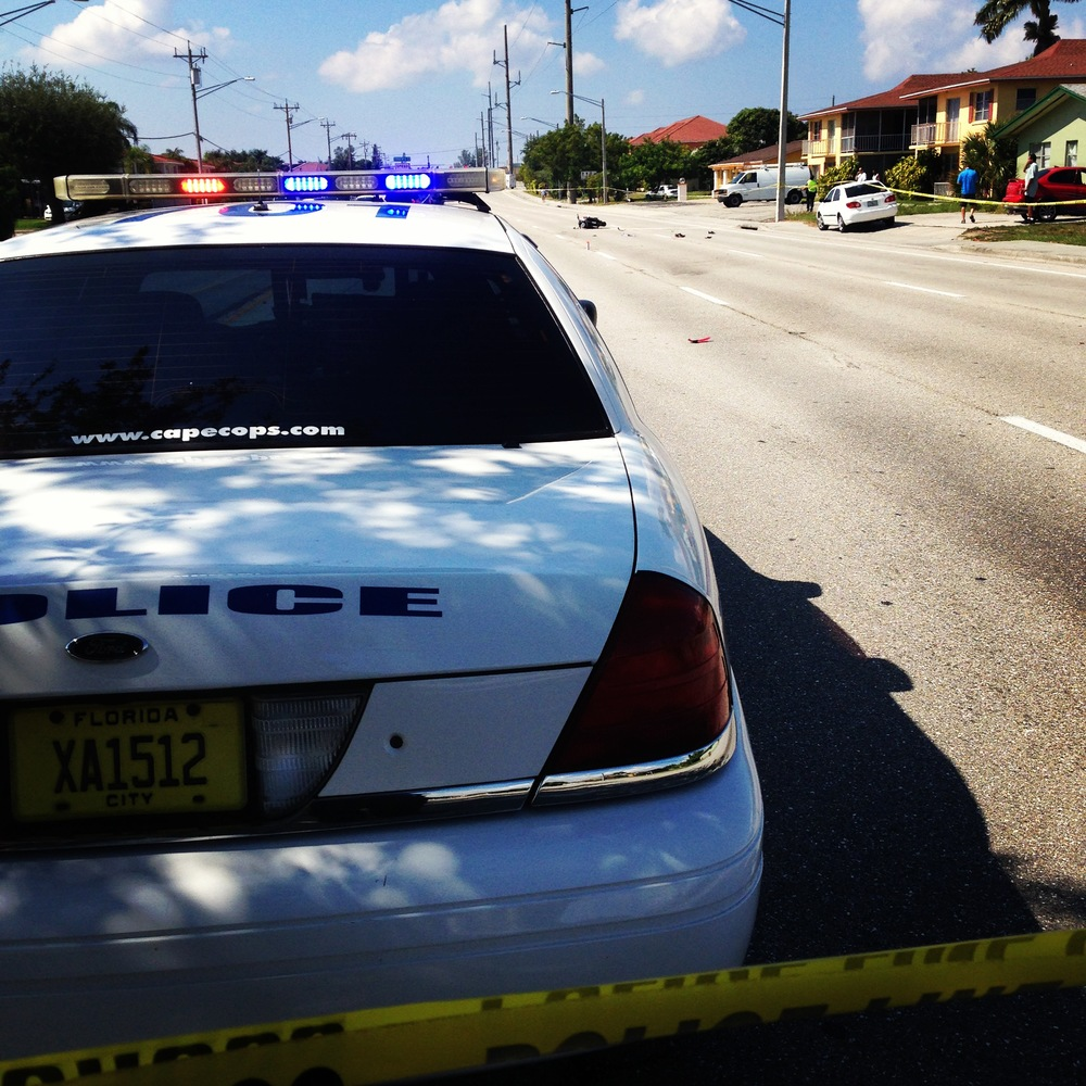 PHOTO:  Crime scene tape and marked cars cordon off the scene of a serious injury crash in the 200 block of Cape Coral Parkway East.  (Photo Courtesy of Cape Coral Police Department)