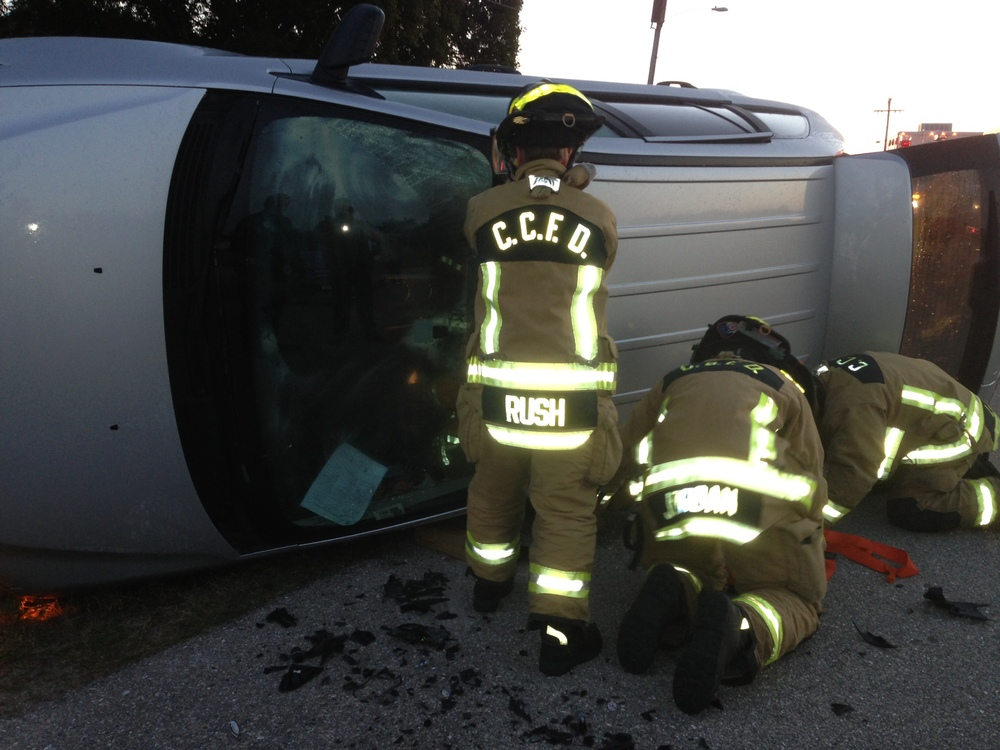 PHOTO:  Cape Coral Police, Fire and EMS responded to roll-over crash in the 5100 block of SW. 16th Pl.  Pictured here, CCFD personnel begin to extricate the driver from the overturned vehicle.  (Photo Courtesy of Cape Coral Police Department Sgt. Joe Zalenski)