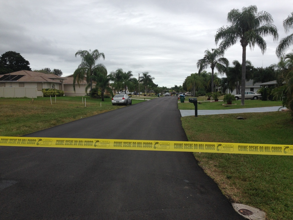 PHOTO:  Yellow crime scene tape marks a scene where Detectives had a violent confrontation with a subject in the 3900 block of SE 4th Avenue.  (Photo Courtesy of Cape Coral Police Department)
