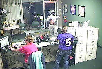 PHOTO: Still images from armed robbery.  The suspects appear to be about 6' tall and 200 lbs. They fled southbound on foot and no vehicle description is available at this time. They were described as black males, but the suspect in the gray hoodie looks to be possibly Hispanic  . (Photo Courtesy of  Cape Coral Police Department  )
