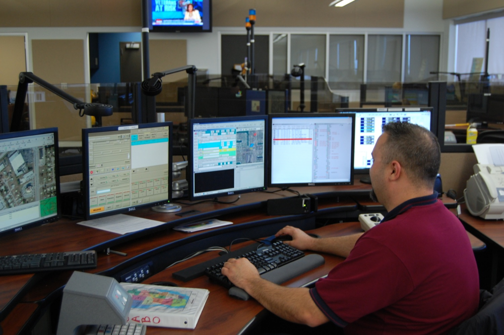 PHOTO:  A dispatcher monitors calls at his console.  (Photo Courtesy of Cape Coral Police Department)
