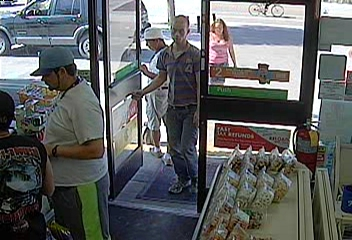 PHOTO: Still photos from a 7-11 security camera showing burglary/credit card fraud suspects- awhite male (slender build) wearing a polo shirt and blue jeans and the white female wearing a pink striped tank top and jean shorts. (Photo Courtesy of Cape Coral Police Department)