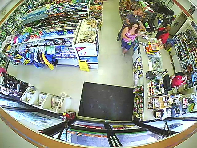 PHOTO: Still photos from a 7-11 security camera showing burglary/credit card fraud suspects- awhite male (slender build) wearing a polo shirt and blue jeans and the white female wearing a pink striped tank top and jean shorts. (Photo Courtesy ofCape Coral Police Department)