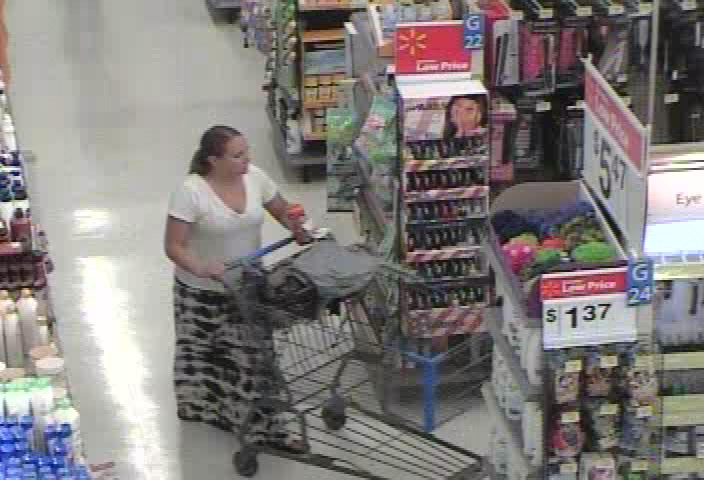 PHOTO:  Stills taken from a surveillance camera show a W/F suspect, late 20's to early 30's, with brown hair pulled into a ponytail.  She attempted to leave Wal-Mart without paying for items.  She fled in a blue Ford SUV.  (Photo Courtesy of Cape Coral Police Department)