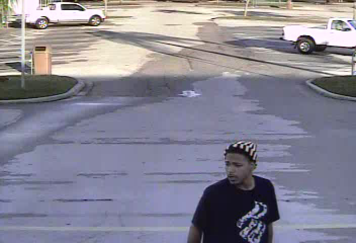 PHOTO:  Retial theft suspect is described as a black male, 18-25 years of age, with black hair, brown eyes, approximately 160 pounds, from 5`10 to 6`00 tall, with a back goatee.  The suspect was wearing a black tee shirt, blue jean shorts, and a black and a skull cap..  (Photo Courtesy of Cape Coral Police Department)