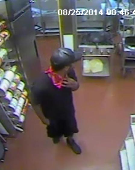 PHOTO: Armed robbery suspect is described as a B/M wearing black shorts, black t-shirt, black ball cap, and a red bandana covering his face. His accomplice who drove a GMC long-bed pickup truck as a getaway car was described as a B/M with long dreadlocks, wearing a neon green t-shirt. (Photo Courtesy ofCape Coral Police Department)